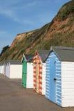 Цветастые хаты пляжа на Seaton, Девоне, Великобритании. Стоковая Фотография RF