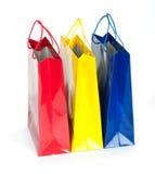Цветастые хозяйственные сумки в рядке стоковые изображения rf