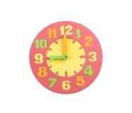 Цветастые часы игрушки в текстурированной пене стоковое фото
