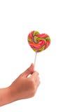 цветастым сформированные lollipops руки изолированные сердцем Стоковые Изображения