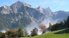 Цвета падения на шпице Regitzer в Graubuenden, Швейцарии Стоковые Фото
