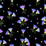 Цветки безшовной картины голубые на черной предпосылке Стоковая Фотография