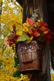 Цветки в ведре стоковое фото rf