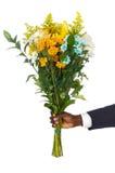 цветки давая руку стоковое фото