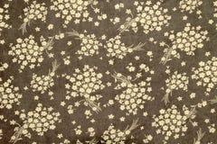 Цветки на предпосылке картины ткани Стоковое фото RF