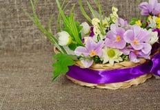 Цветки на предпосылке холста Стоковое Изображение RF