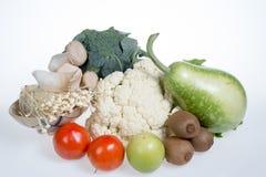 Цветная капуста, киви, томаты, jujubes, брокколи, гриб, золотой гриб иглы и тыква бутылки Стоковые Изображения RF