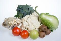Цветная капуста, киви, томаты, jujubes, брокколи, золотой гриб иглы и тыква бутылки Стоковая Фотография RF