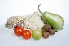 Цветная капуста, киви, томаты, jujubes, брокколи, золотой гриб иглы и тыква бутылки Стоковое Изображение RF