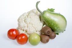 Цветная капуста, киви, томаты, jujubes и тыква бутылки Стоковые Фото