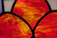 Цветное стекло красного цвета с воздушными пузырями Стоковое фото RF
