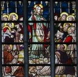 Цветное стекло - проповедь на держателе стоковое фото