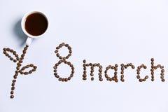 Цветок, солнце и надпись сделанные из кофейных зерен стоковые фото