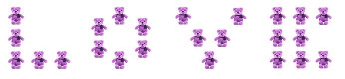 Цвет ПЛЮШЕВОГО МЕДВЕЖОНКА фиолетовый с ВЛЮБЛЕННОСТЬЮ Стоковое фото RF