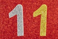 Цвет 11 серебряный желтый над красной предпосылкой Anniver Стоковые Фотографии RF