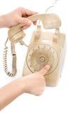 Цвет сливк телефона владением руки винтажный Стоковое фото RF