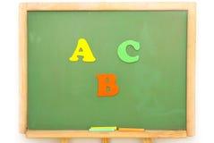 цвет c доски b помечает буквами школу Стоковое Изображение