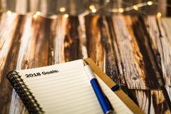 Цели на 2018 на тетради как мотивационная концепция дела Стоковая Фотография