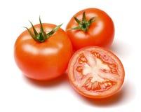Целый и половинные томаты Стоковые Фото