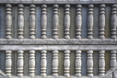 Цементная фактурная решетка забора. Cement textured lattice fence of two-tier part of the fence consisting of curved bars Royalty Free Stock Photography