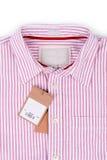 Ценник с штрихкодом на рубашке Стоковое Изображение RF