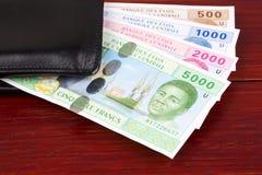 Центрально-африканские деньги в черном бумажнике стоковое фото