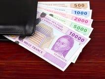 Центрально-африканские деньги в черном бумажнике стоковое изображение