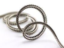 цепной свертываясь спиралью серебр Стоковая Фотография