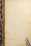 Цепь металла и старая бумага Стоковая Фотография