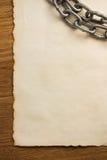 Цепь металла и старая бумага Стоковое Изображение