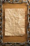Цепь металла и старая бумага Стоковая Фотография RF