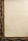 Цепь металла и старая бумага Стоковые Фотографии RF