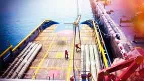 Цепь шланга экспорта вне на корабле Стоковые Изображения