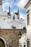 Церковные колокола в районе старого городка историческом Faro Стоковые Изображения RF