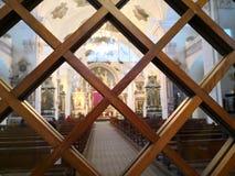 Церковь через окно Стоковые Изображения