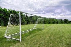 Цели футбола на поле Стоковое Изображение
