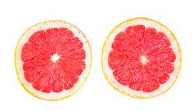 Цитрусы конца-вверх экзотические изолированные на белой предпосылке Насыщенный красный грейпфрут совершенно отрезанный в половине Стоковые Изображения