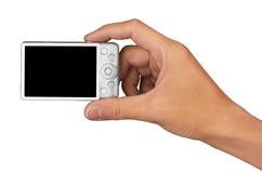 Цифровой фотокамера в руке Стоковое Изображение