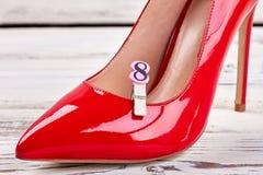 Цифр 8 и женский ботинок Стоковые Изображения RF