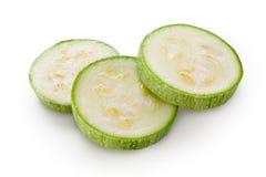 Цукини. Отрезанный зеленый courgette на белой предпосылке Стоковое фото RF