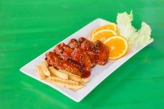 Цыпленок в соусе томата и перца Стоковые Фото