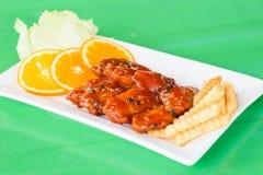 Цыпленок в соусе томата и перца Стоковое Изображение