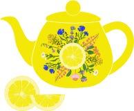 Чайник лимона с травами и лимоном Стоковые Изображения