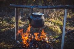 Чайник на огне Стоковые Фото