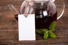 Чайник с белым ярлыком Стоковая Фотография RF