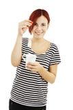 Чай молодой женщины выпивая Стоковое фото RF
