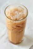 Чай молока на белой предпосылке Стоковое фото RF