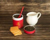 Чай, печенья и опарник Стоковые Изображения