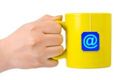 чай символа руки чашки стоковая фотография