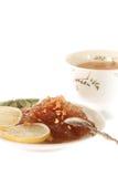 Чай с вареньем и лимоном Apple и изолированное spon Стоковое Изображение RF